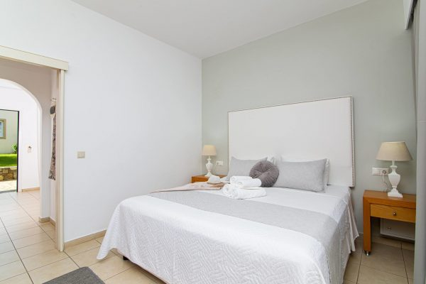 Luxury One Bedroom Apartments with Sea View bedroom and hallway