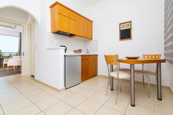 Luxury One Bedroom Apartments with Sea View Kitchenette and dining table