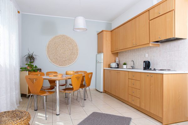 Family Two Bedroom Apartments with Sea View or Garden View Kitchenette and dining table