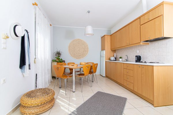 Family Two Bedroom Apartments with Sea View or Garden View living room and dining table