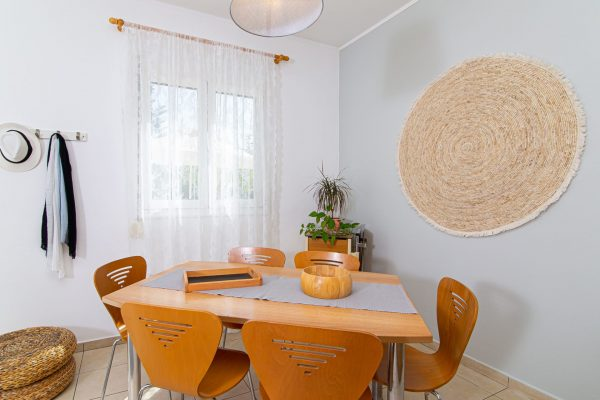 Family Two Bedroom Apartments with Sea View or Garden View dining table