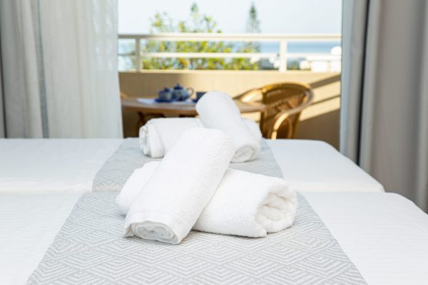 Superior Triple Studios with Sea View or Garden View bed detail