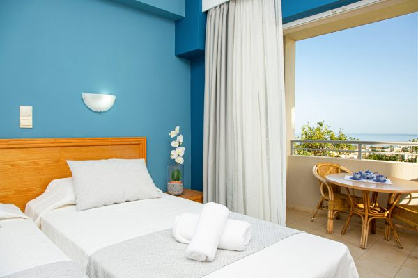 Superior Triple Studios with Sea View or Garden View balcony view