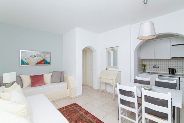 Luxury One Bedroom Apartments with Sea View living area with dining table