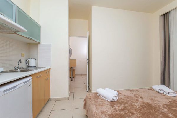 One Bedroom Quadruple Apartment bedroom
