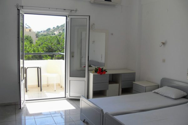 Standard Twin/Double Studio single beds and balcony view