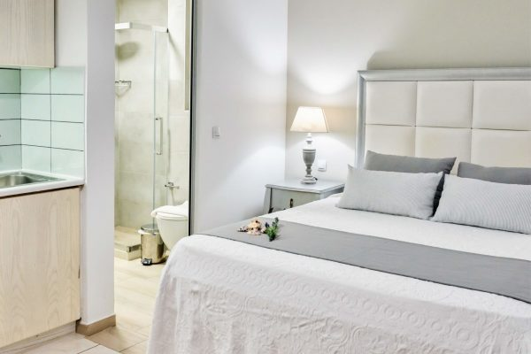 Superior Triple Studios with Sea View or Garden View Bed and bathroom
